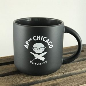 A black stoneware mug with the AP vs. Chicago logo.